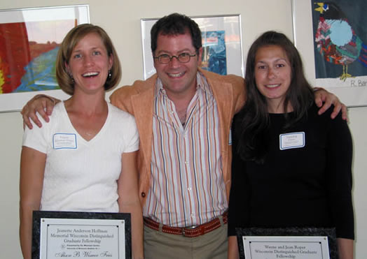 Seth Pollak congratulates award winners Alison Wismer Fries and Sandra Klein