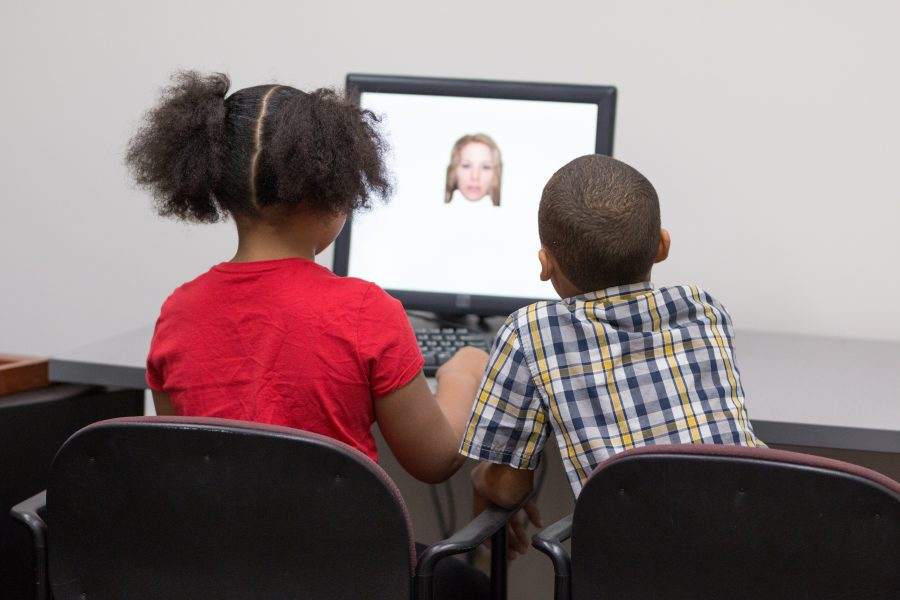 Participants looking at computer