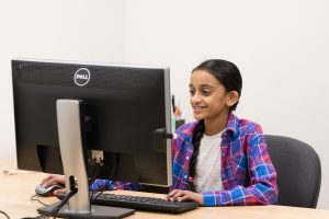 Participant looking at computer while smiling